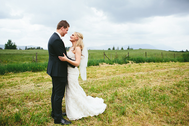 bride and groom in field BC