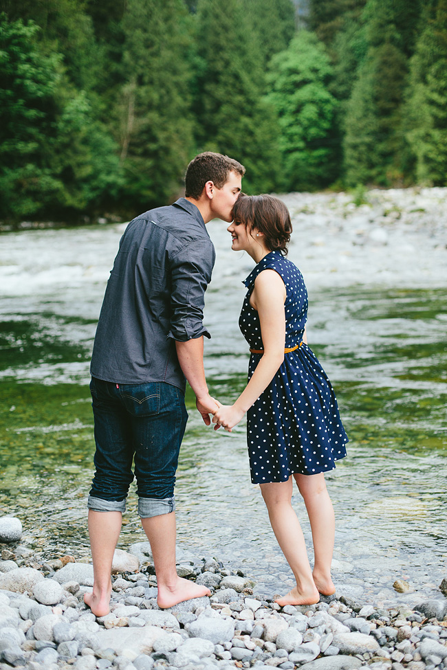 kissing in the river engagement photos